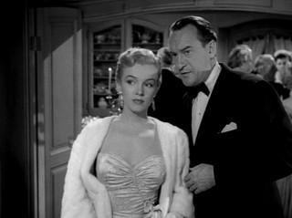 """Marilyn Monroe y George Sanders en """"Eva al desnudo"""""""